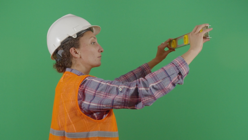 Woman Engineer Using A Level On Green Screen. Studio Isolated Shot Against Green Screen Background | Shutterstock HD Video #1040503136