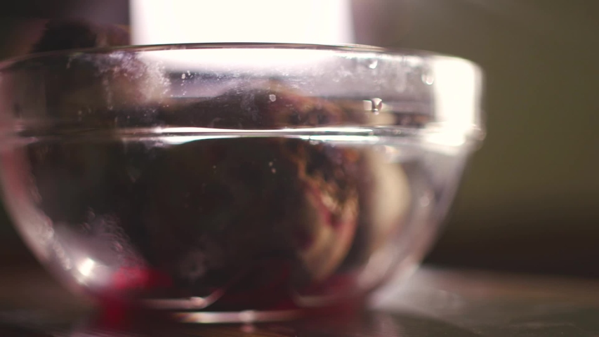Cook takes boiled beets from a glass cup #1040511086