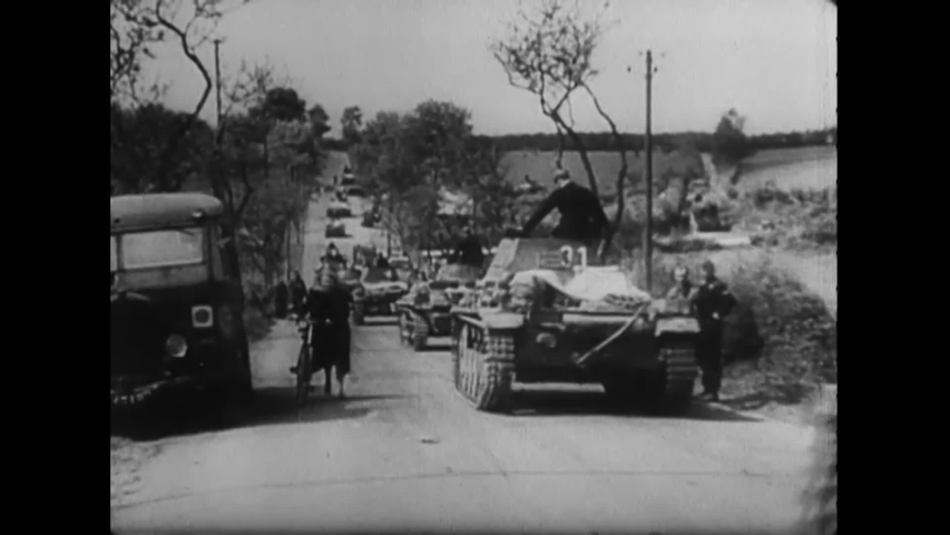 CIRCA 1945 - Nazi armored units move down a French countryside. Nazi soldiers load oil drums onto freight trains and trucks.