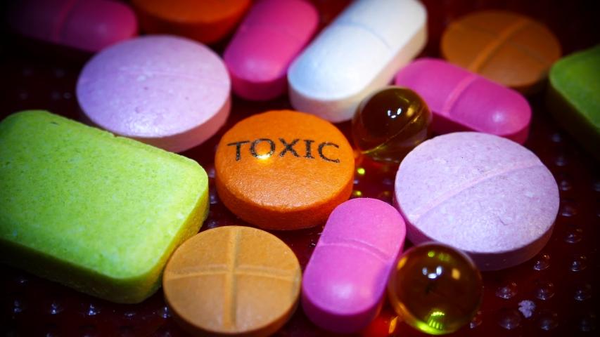 TOXIC caption print on medicine drug pill laser sci fi illustration 4k | Shutterstock HD Video #1040786246