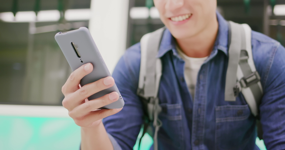 Close up of asian young man use 5g smartphone on the mrt or train | Shutterstock HD Video #1040827286