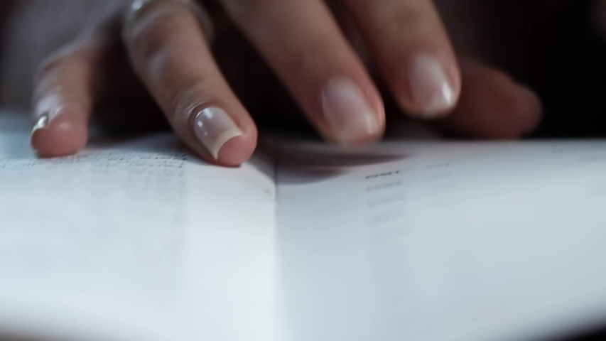 Woman hands listing a restaurant menu, close up | Shutterstock HD Video #1040908676