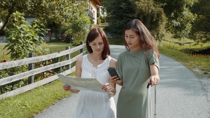 Travelers girls searching a booking address | Shutterstock HD Video #1041082606