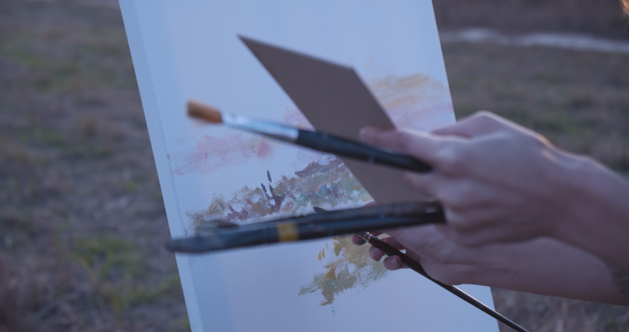 Amateur painter working with brushes and pastel colors on canvas, art workshop   Shutterstock HD Video #1041088186