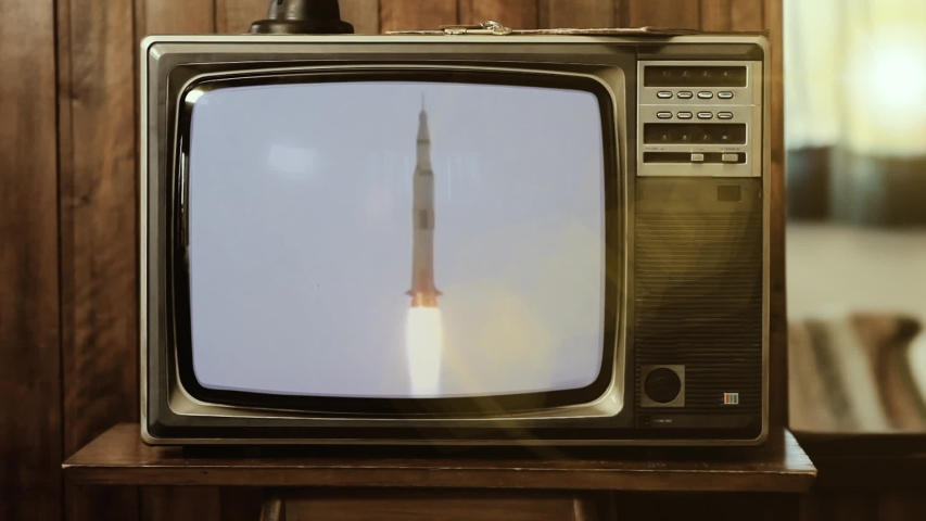 1969. Historical Footage Of The Saturn V Rocket Launch Of Apollo 11 Mission, on a Vintage Television. Elements of this Video furnished by NASA. | Shutterstock HD Video #1041245926