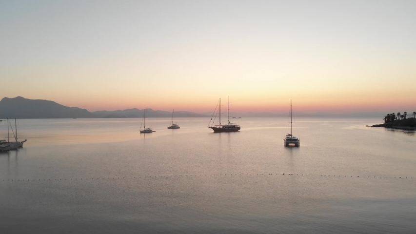 Anchored sailing ships in Datca harbor and a great sunrise. Aerial shots | Shutterstock HD Video #1041417436