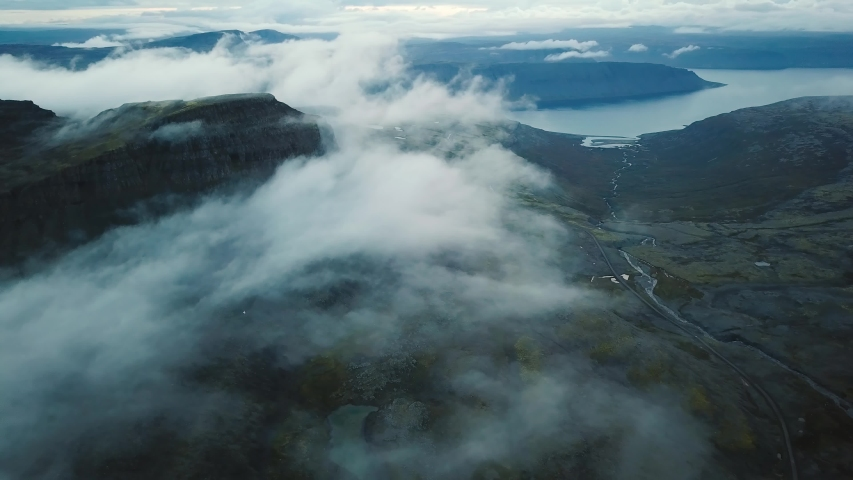 Flying above clouds in West Fjords in Iceland, beautiful landscape | Shutterstock HD Video #1041493396