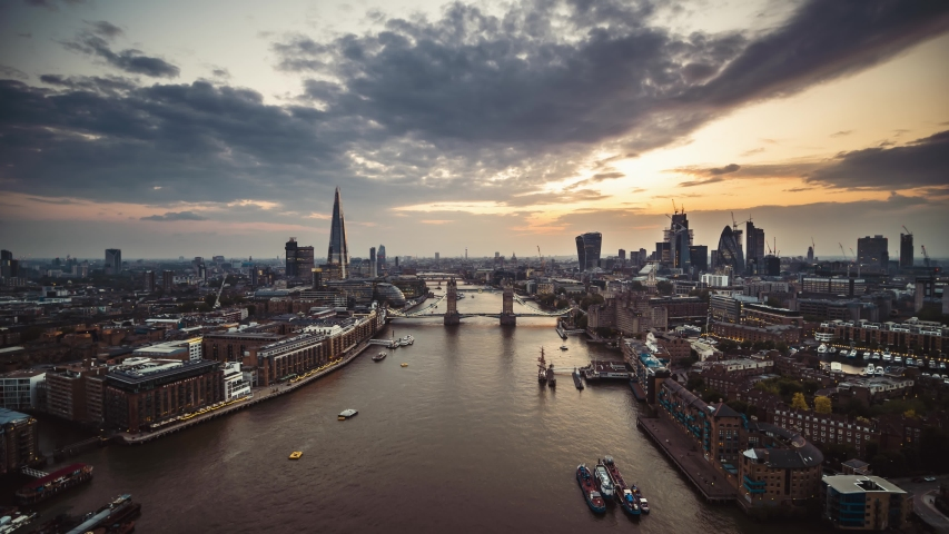 Establishing Aerial View shot of London Tower Bridge City Skyline Thames River Shard Great Britain United Kingdom slow track in drone helicopter during amazing sunset in May | Shutterstock HD Video #1041569956