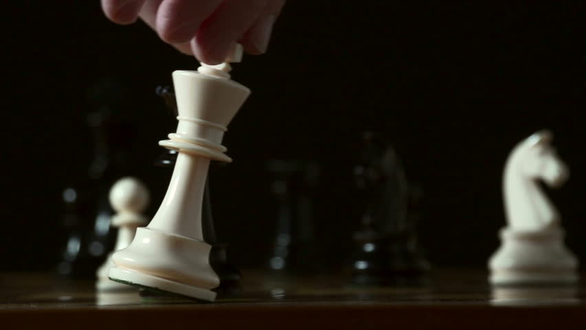 Defeat in slow motion -- chess player resigns by knocking over his king with his hand. Graceful, smooth slo-mo, shot at 240fps on the Sony FS700.