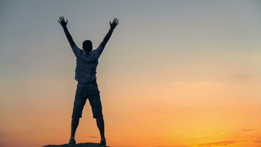Success achievement running or hiking accomplishment business and motivation concept with man sunset silhouette celebrating arms up raised outstretched trekking climbing running outdoors in nature | Shutterstock HD Video #10416710
