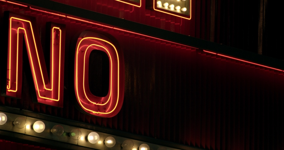Close crop of bright illuminated sign saying NO   Shutterstock HD Video #1042034686