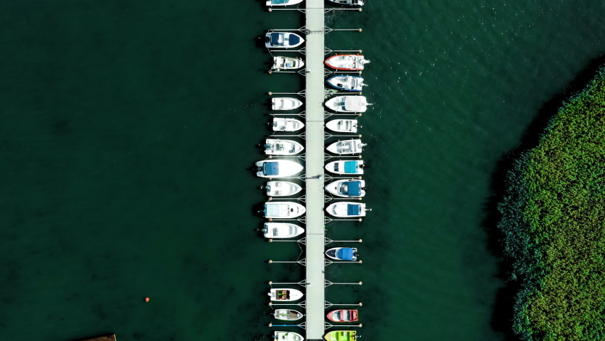 Aerial, top down, drone shot, over boats at a quay, on the gulf of Finland, on a sunny, summer day, in Laajalahti, Espoo, Uusimaa | Shutterstock HD Video #1042192096