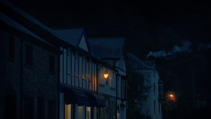 Village Storefronts In The Evening With Smoking Chimney | Shutterstock HD Video #1042433746