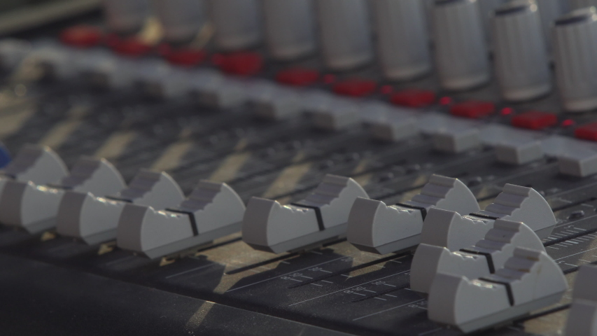 Audio sound mixer, hand moving slides and knobs, music equipment  | Shutterstock HD Video #1042539976
