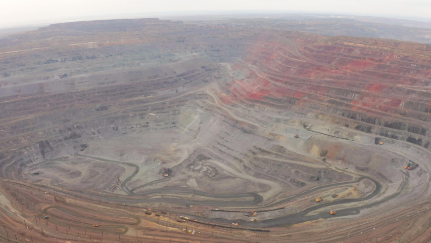 Aerial view of opencast mining quarry with lots of machinery at work | Shutterstock HD Video #1042578136
