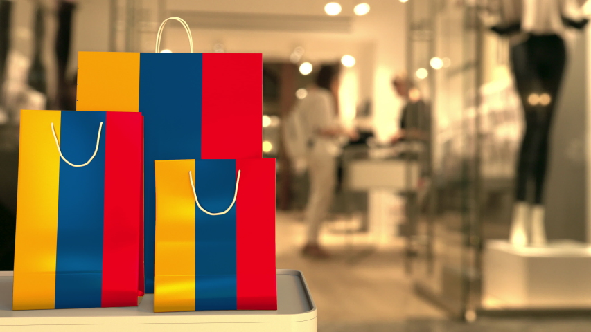Flag of Armenia on the paper shopping bags against blurred store entrance. Retail related clip | Shutterstock HD Video #1042614886