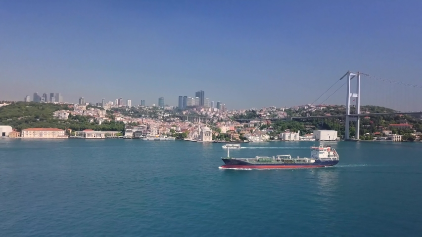 Aerial. Oil chemical tanker sailing along the Bosporus shore in Istanbul City. Oil Tanker traffic is getting denser as the need for the transportation of Asian and Caucasian petroleum increases  | Shutterstock HD Video #1042727026