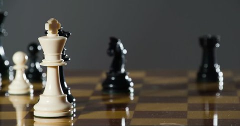 Defeat in slow motion -- chess player resigns by knocking over his king with his hand. Graceful, smooth slo-mo, shot at 120fps in 4K RAW on the Sony FS700 recorded in full detail on the Odyssey 7Q.