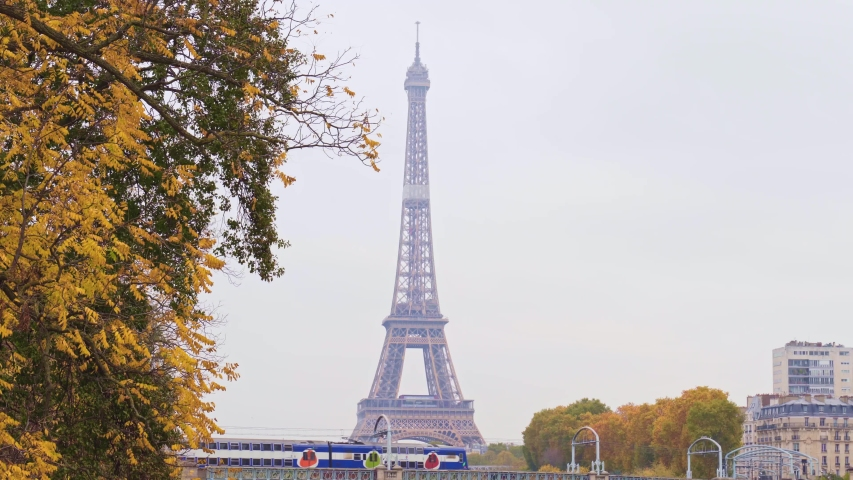 Eiffel Tower with metro rer line and high-rise buildings in Paris, in a cloudy autumn day | Shutterstock HD Video #1042912426