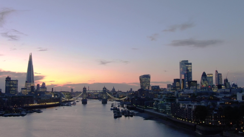 Aerial view of City of London Skyline Tower Bridge and Thames River at sunset in London | Shutterstock HD Video #1043226586