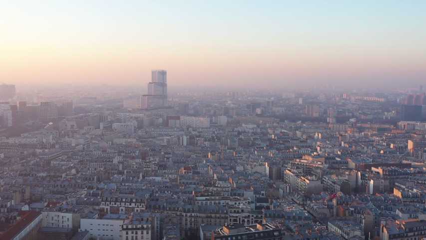 Aerial view of Paris Judicial Campus Batignolles France skyline rooftops pollution sunset  | Shutterstock HD Video #1044657106