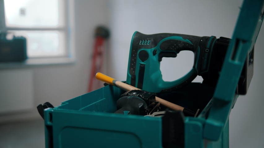 A man worker pulling a hammer out of the case | Shutterstock HD Video #1044746176