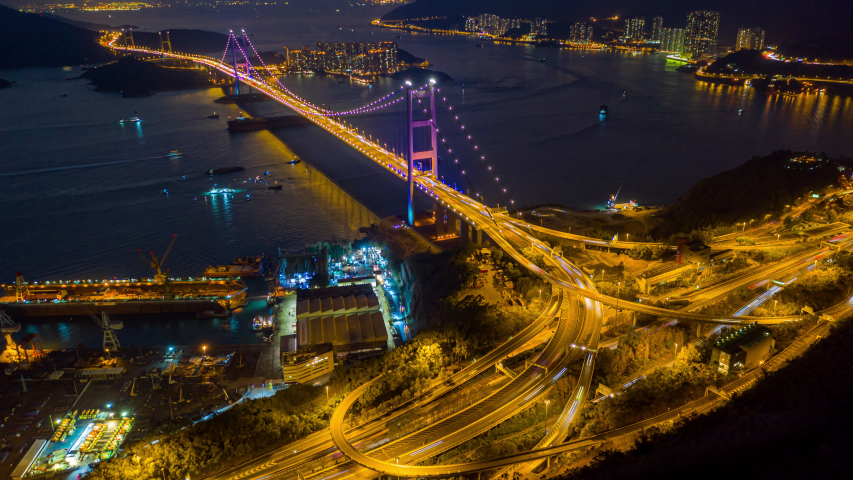 Hyperlapse or Dronelapse Aerial view of Traffic of car at Tsing ma bridge in Tsing yi area of Hong Kong at night   Shutterstock HD Video #1044848296