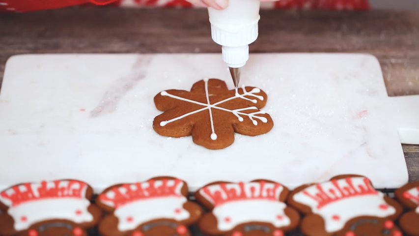 Step by step. Decorating gingerbread cookies with royal icing.   Shutterstock HD Video #1044885586