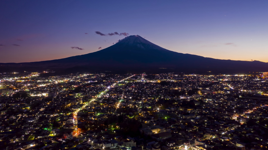 Aerial view Hyper lapse 4k Video of Mount Fuji on sunset at Fujiyoshida city, Yamanashi, Japan. mt. fujisan hyperlapse by drone. | Shutterstock HD Video #1044936376