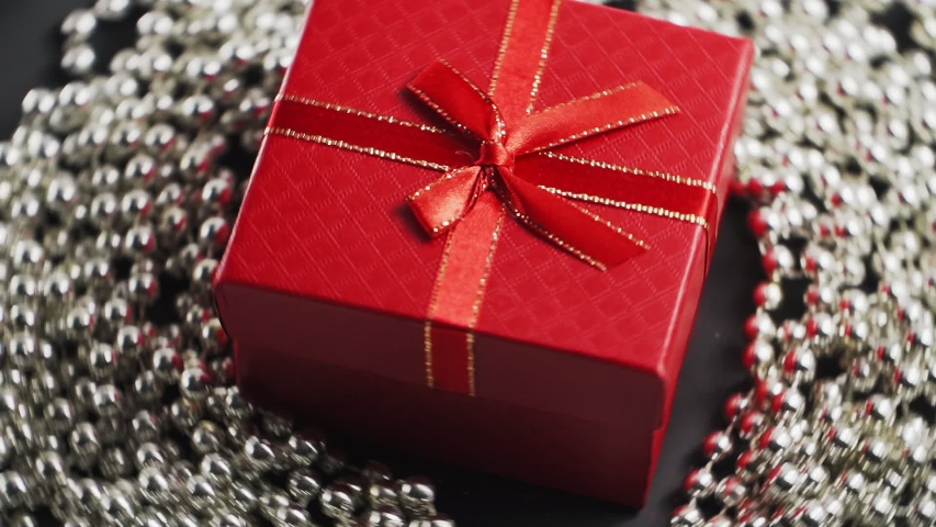 Beautiful red gift box revolves 360 degrees. Holidays and gifts. On a white background. | Shutterstock HD Video #1045025686