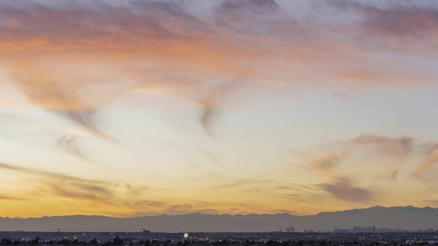 Sunset timelapse of the famous Las Vegas Strip skyline with mountain behind at Nevada | Shutterstock HD Video #1045069456