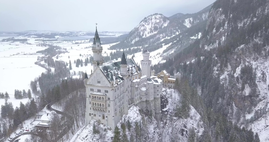 Neuschwanstein Castle in Winter Day . Mountains and Rocks. Bavarian Alps, Germany. Aerial View. Wide Shot. Drone is Orbiting Clockwise | Shutterstock HD Video #1045193236