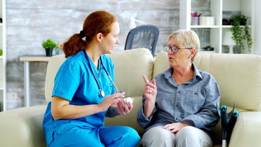 Female doctor consultin a senior woman about pills dosage and subscription, they are in a nursing home | Shutterstock HD Video #1045292296