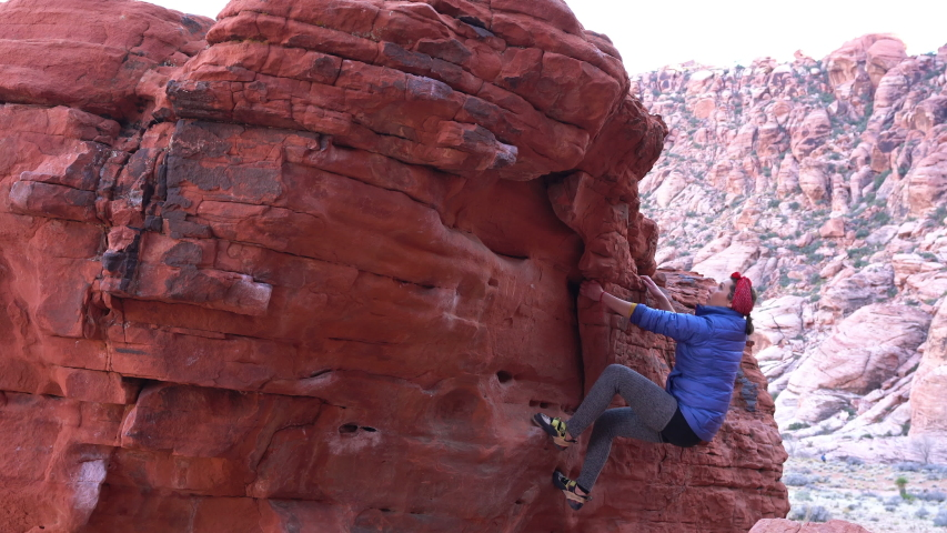 Rock climbing athletic woman successfully tops out on difficult boulder problem | Shutterstock HD Video #1045349866