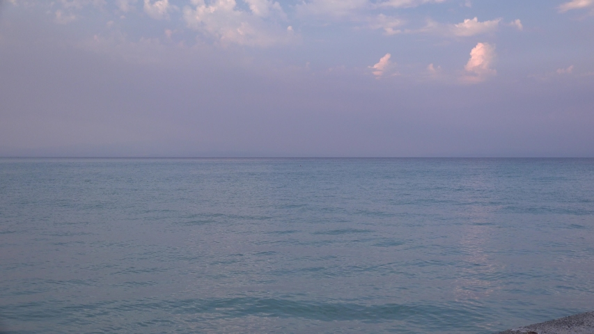 Summer waterscape with calm sea at sunset. Summer travel concept. | Shutterstock HD Video #1045403866