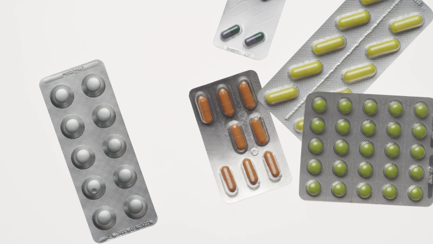 Pills blisters, tablets, vitamins, drugs,medicament and food supplement for health care. Pharmaceutical industry. Pharmacy. Isolated on white background.  | Shutterstock HD Video #1045575526