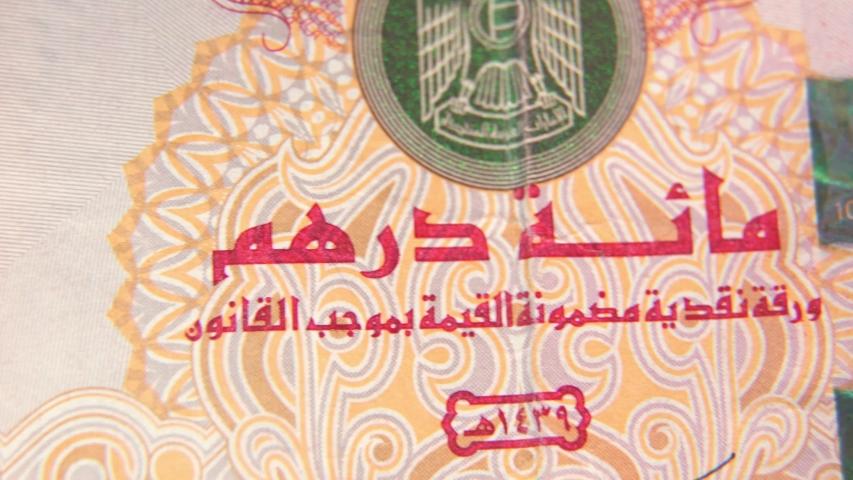 Macro shot of the United Arab Emirates currency 100 dirhams , 4K UHD video footage. | Shutterstock HD Video #1045717756