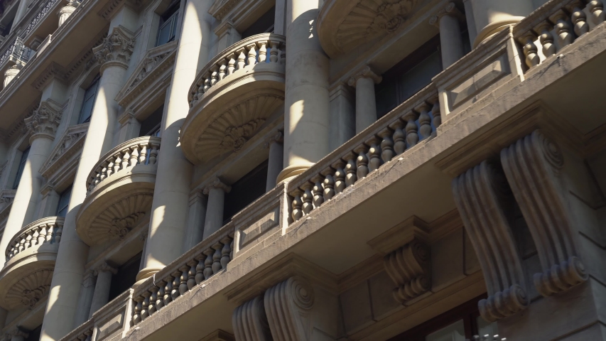 Beautiful balconies of an old building, bottom view | Shutterstock HD Video #1046152966