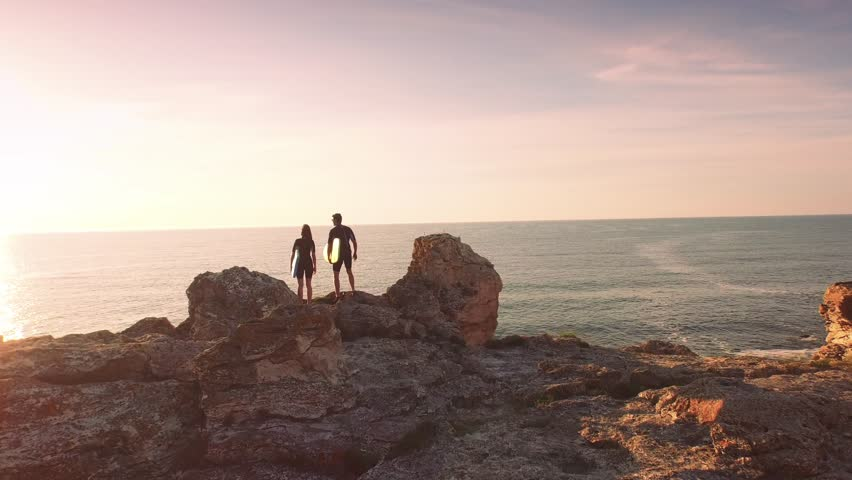Young Surfers Man Woman Walking Standing On Top Of Cliff High Five Congratulations Achievement Sports Holiday Vacation Happiness Concept