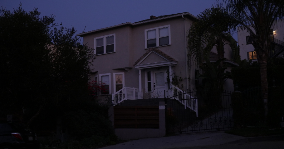 An upscale house exterior, establishing shot with a locked off angle at night. Affluent neighborhood with palms trees in Los Angeles or San Diego California. Native 10bit 422 prores  | Shutterstock HD Video #1046444836