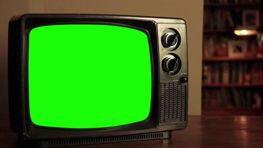 """Retro 70s TV Set with Green Screen in the Living Room. Zoom In. You can Replace Green Screen with the Footage or Picture you Want with """"Keying"""" effect in After Effects (check out tutorials). 