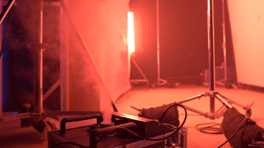 Film light and smoke equipment LED red color effect cinema commercial video production slow motion camera movement | Shutterstock HD Video #1046761546