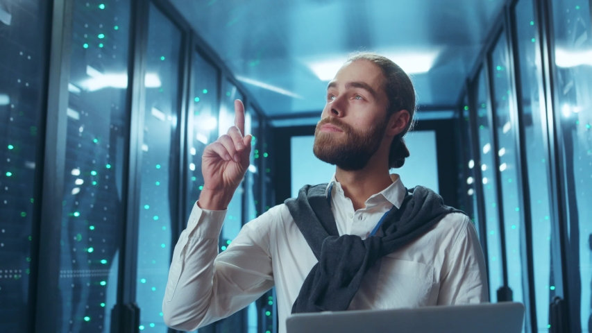 Pensive smart IT specialist developing an efficient idea for network maintenance using a laptop computer in data center server room.   Shutterstock HD Video #1046828446