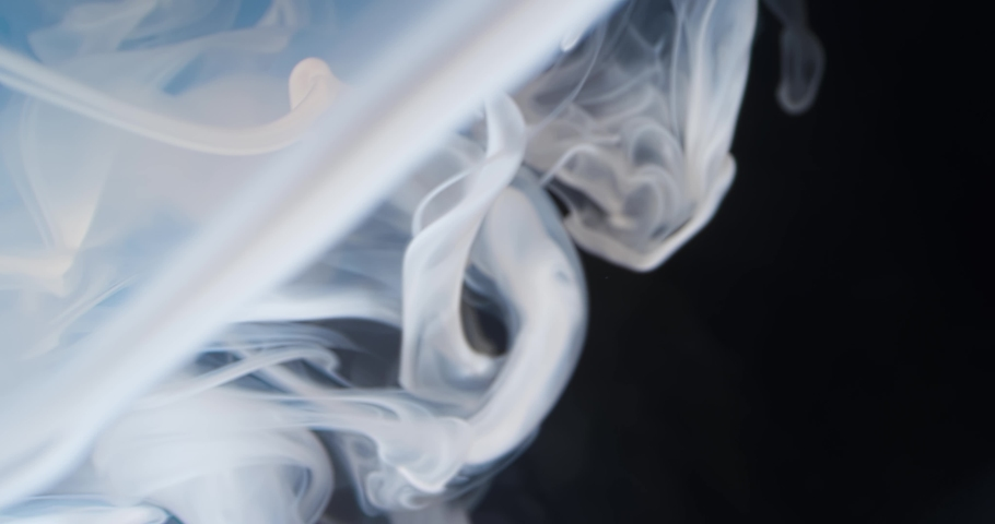 White  Fluid  in Motion underwater. Black Background. Macro.  Liquids Threads. | Shutterstock HD Video #1046871046