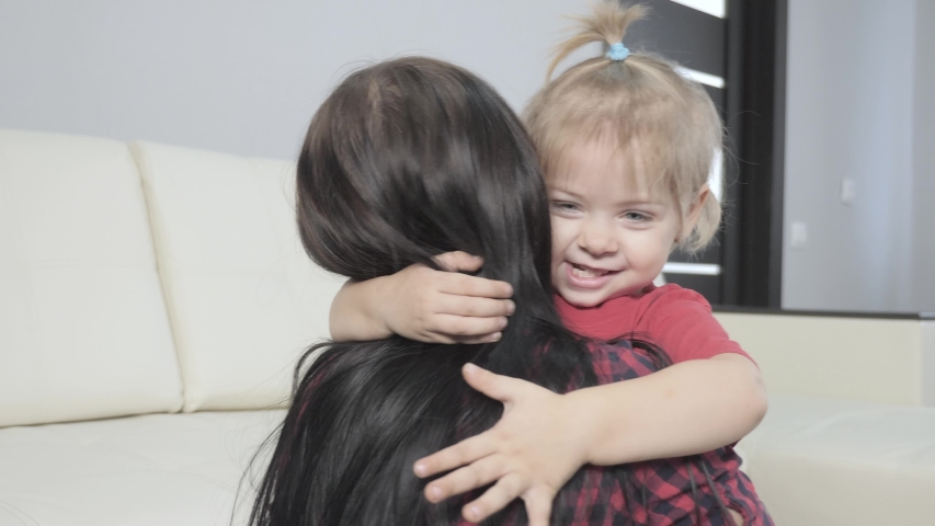 Happy family little daughter hugs mom indoors. little girl hugs woman lifestyle in remembrance joy happiness a happy family | Shutterstock HD Video #1046890876