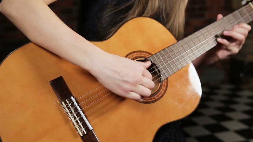 Video of girl playing the guitar | Shutterstock HD Video #1046968666