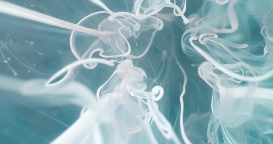 White  Fluid  in Motion underwater. Macro.  Liquids Threads. | Shutterstock HD Video #1047055186