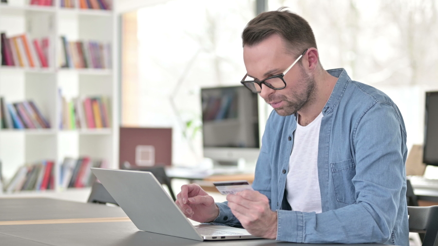 Online Shopping Failure for Young Man in Glasses on Laptop | Shutterstock HD Video #1047248476