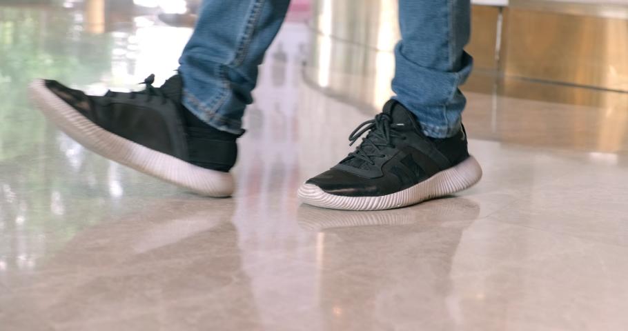 Moon walk in shopping mall. Asian teenager in sport shoes. | Shutterstock HD Video #1047252586