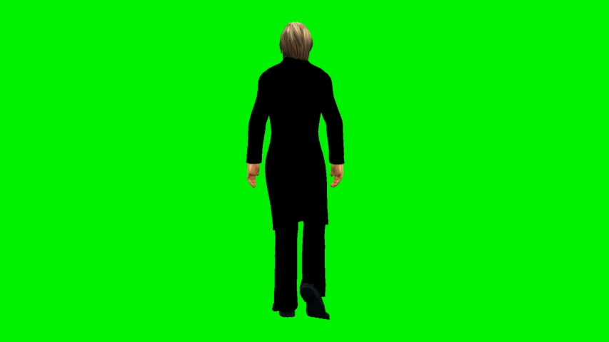 A man dressed in black walks away from the camera on a green screen. | Shutterstock HD Video #1047287446